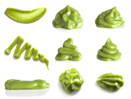 Collection of green wasabi sauce isolated on white background