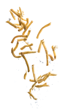 French fries with salt explode flying in the air isolated