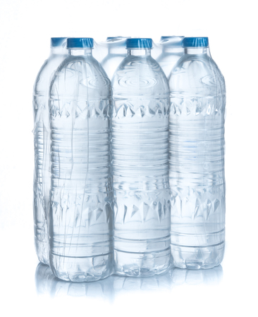 Plastic bottles water in wrapped package on white