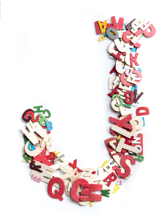 Colorful wood alphabet letters on white background,letter J