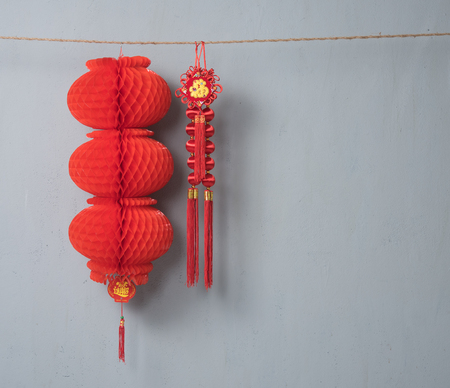 Traditional Chinese new year decoration on the rope on grey concrete textured
