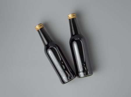 Mini wine bottle on grey background for print design and mock up