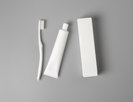 toothbrush with paste and box mock up,top view 免版税图像