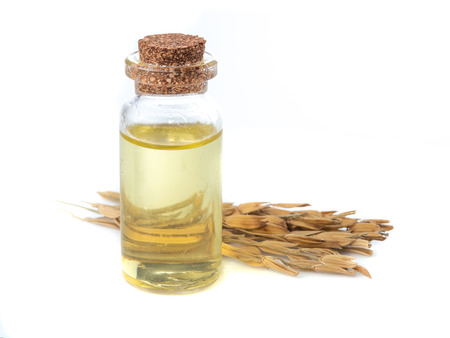 rice paddy with rice bran oil in glass bottle on white background Stok Fotoğraf