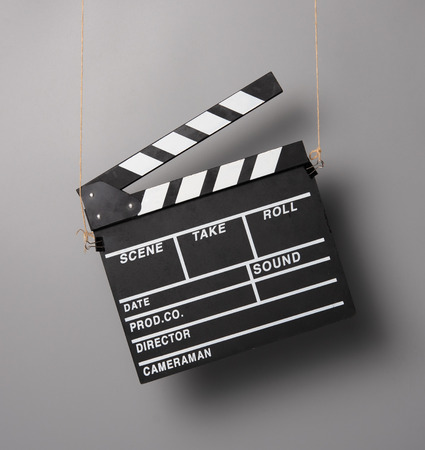 Clapper for movie Photo taken hanging on ropes,gray background Banco de Imagens