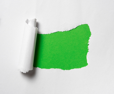Torn paper with space for text on green background Stockfoto