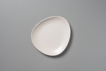 Top view empty white plate on grey background with shadow
