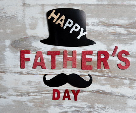 Happy Fathers Day concept,hat, black mustache with Happy father's day text on wooden table Stock fotó