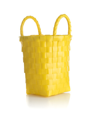 Yellow plastic wicker basket on white background 版權商用圖片