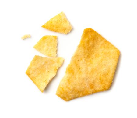 broken potato chips isolated on white background