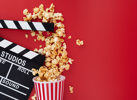 Clapper board with popcorn against red