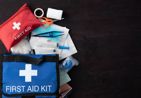 First aid medical kit on wood