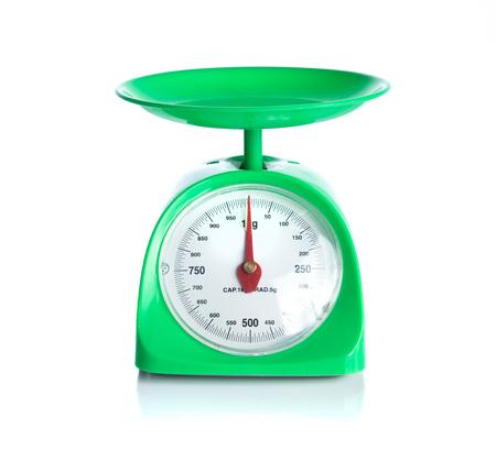 Green kitchen scales isolated on white 版權商用圖片