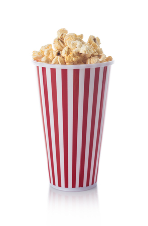 Full red bucket of popcorn isolated on the white Imagens
