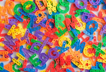 Colorful plastic alphabet letters on white background,Top view.