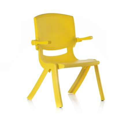 Children yellow plastic chair isolated on white background