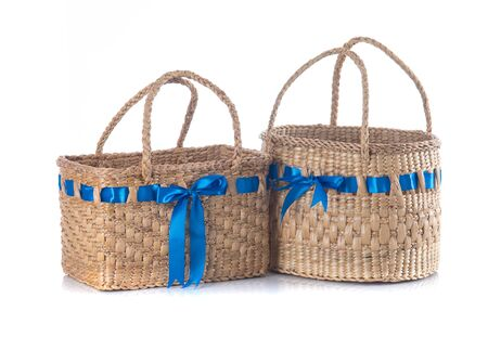 Handmade basket from water hyacinth isolated on white background