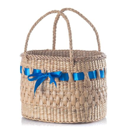 Handmade basket from water hyacinth isolated on white background Фото со стока