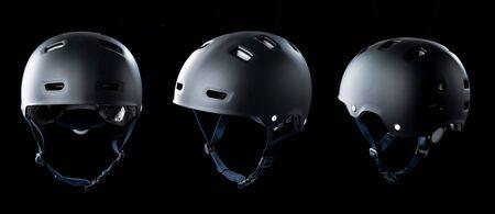 Black skater helmet on black background