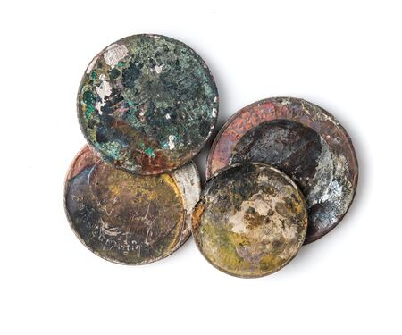 Old rusted coins,Oxidized old coins on white background.