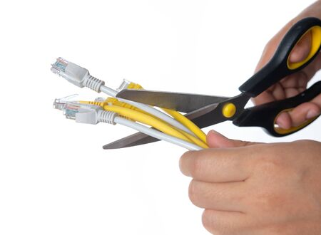 Scissors cutting the network cable on white backgrund