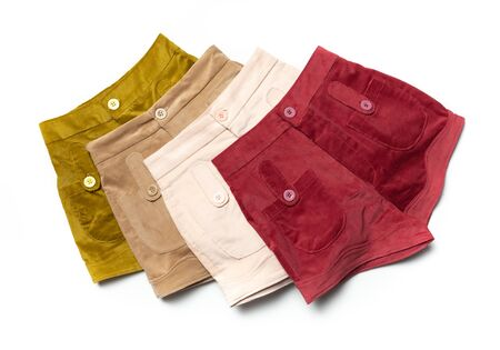 Four colored shorts, red, white , Brown and yellow shorts on white. Stock Photo