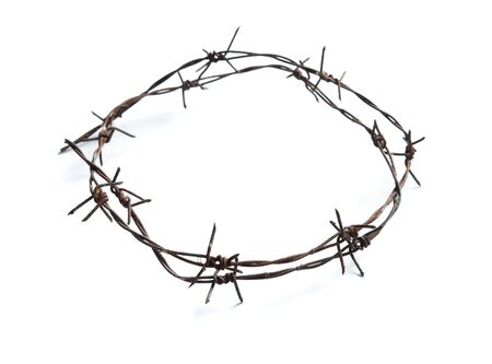 Old rusty barbed wire circle isolated on white background
