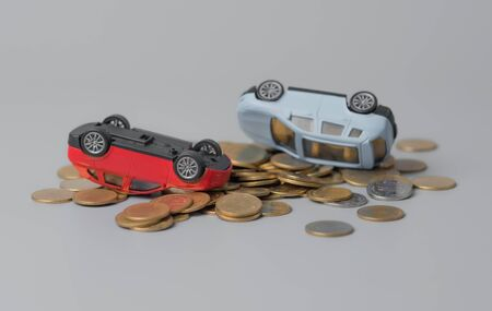 Car accident on stack of golden coins 版權商用圖片