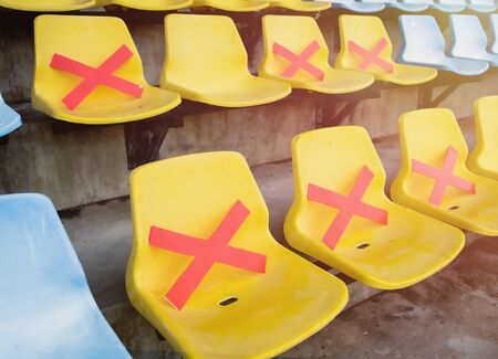 Social distance concept;Chair in stadium. Keep space between chair during Coronavirus (Covid-19) pandemic Social distancing, New normal, Healthcare concept.
