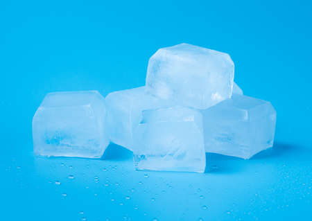 Cubes of ice on blue background