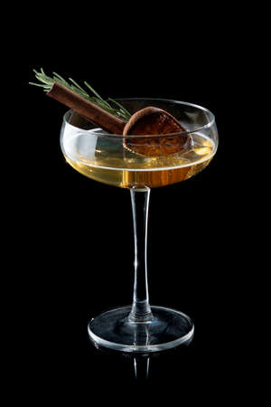 Cocktail and cinnamon syrup with rosemary on the black background Banque d'images