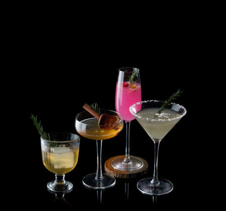 Colorful cocktail and Whiskey on the black background