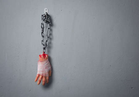 Halloween decorations,Fake Severed Hand with Blood hanging on the wall Banque d'images
