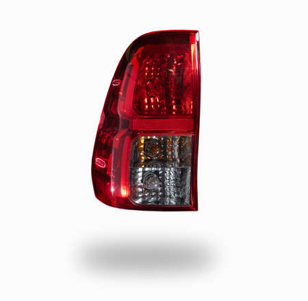 Closeup of rear light of car isolated on white background