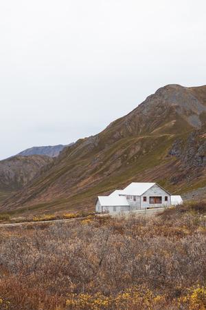 White Vintage Building in Mountains of Alaska Stock Photo