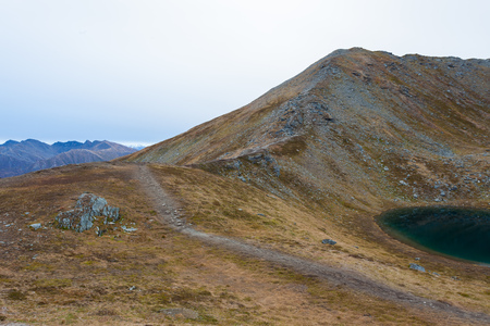 Trail leading up Mountain Ridge by Pond