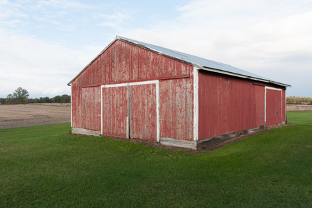 Faded Red Barn on Grassy Lot in Rural Country