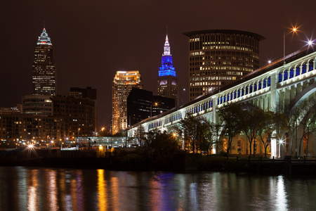 Cleveland, OhioUSA - November 9th 2017: The Detroit Superior bridge lit up with lights at night with the Cleveland skyline in the background.