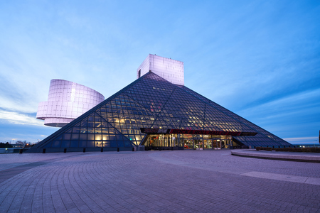 Cleveland, Ohio/USA - March 5th 2018: The Rock and Roll Hall of Fame in the evening lit up with lights and a blue sky in the background.