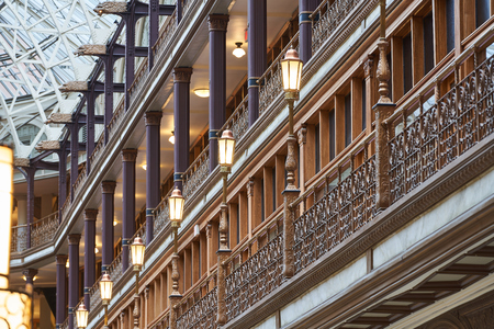 Cleveland, Ohio/USA: Lampposts lining a balcony in the Old Arcade in Downtown Cleveland. Given National Historic Landmark status in 1975, the Arcade is of Victorian architectural.