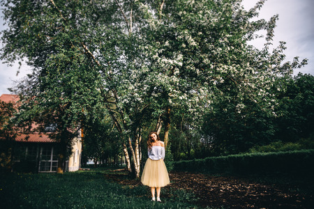 The girl in the spring park Imagens
