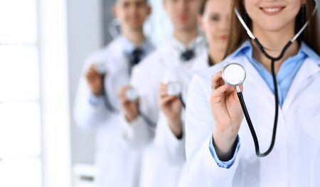 Groupe of medicine doctors holding stethoscope head closeup. Physicians ready to examine and help patient. Medical help and insurance in health care, best treatment concept. Photo for advertisement. 스톡 콘텐츠