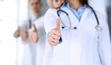 Group of modern doctors standing as a team with arms crossed in hospital office. Physicians ready to examine and help patients. Medical help, insurance in health care, best desease treatment and medicine concept. Zdjęcie Seryjne