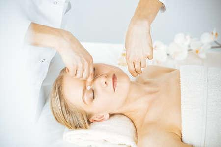 Beautiful caucasian woman getting face depilation procedure. Beauty and Spa salon concept