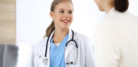 Woman - doctor consults her female patient in clinic. Medicine concept