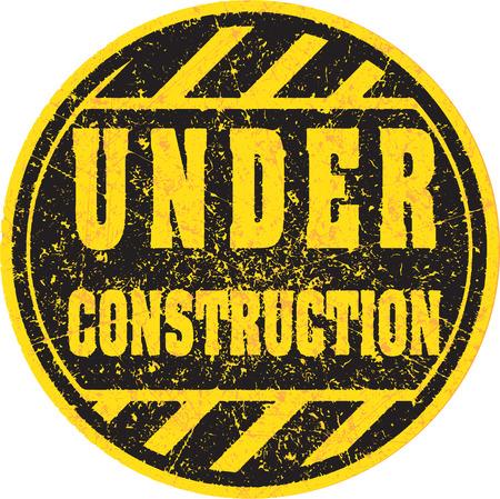 Timbro di gomma o segno In costruzione Archivio Fotografico - 42581524