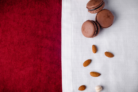 Macaroni with almonds on a red and white tablecloth