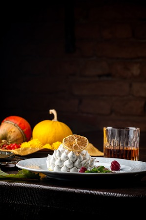 A Halloween Meal. A dish at a restaurant for Halloween celebrations. Black background, brick wall and wooden table