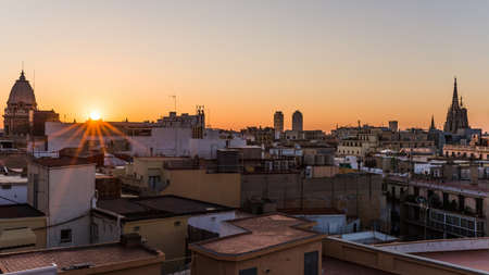 barcelona cathedral: sunrise over the houses of barcelona with view on the cathedral