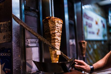 ner: cutting doner meat in a street restaurant in istanbul